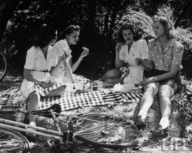 Rita Hayworth and friends enjoying a picnic photographed by  Peter Stackpole for Life Magazine.